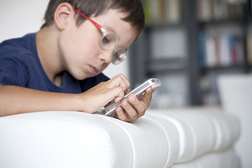 kid scratching cell phone